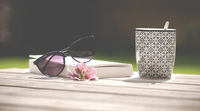 book with sunglasses and cup of tea