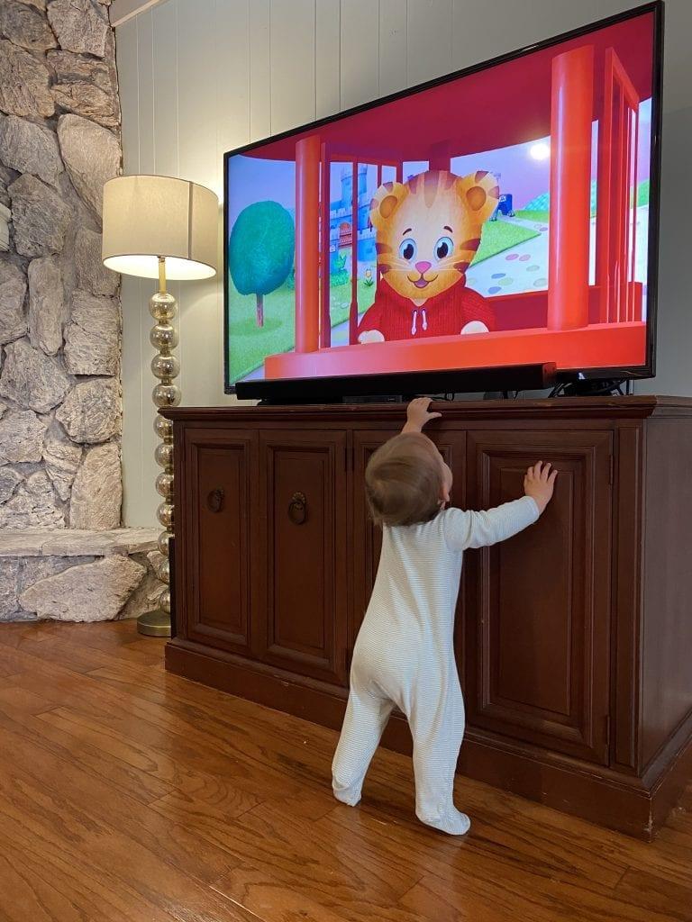 toddler watching Daniel Tiger on television