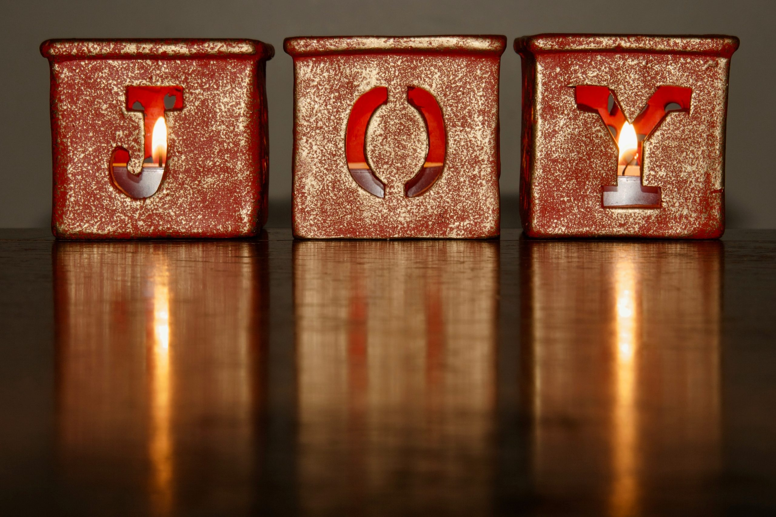 candleholders that spell out JOY