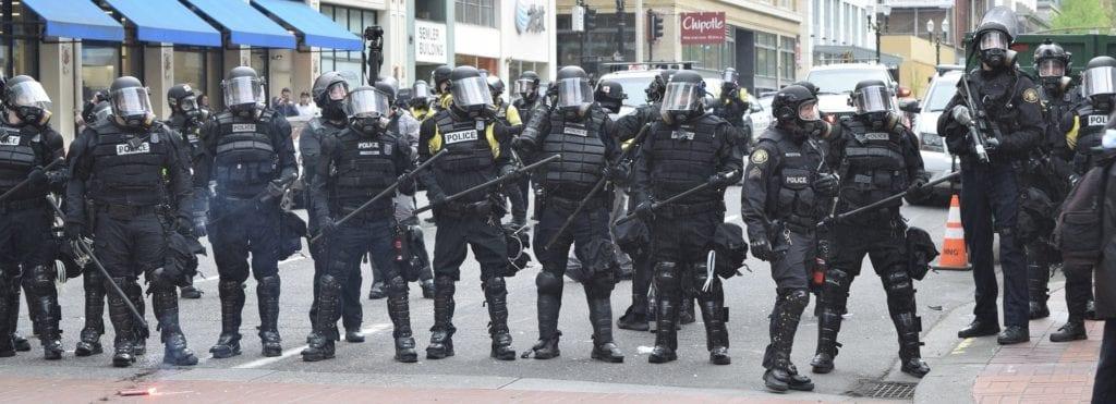 swat team lining the street